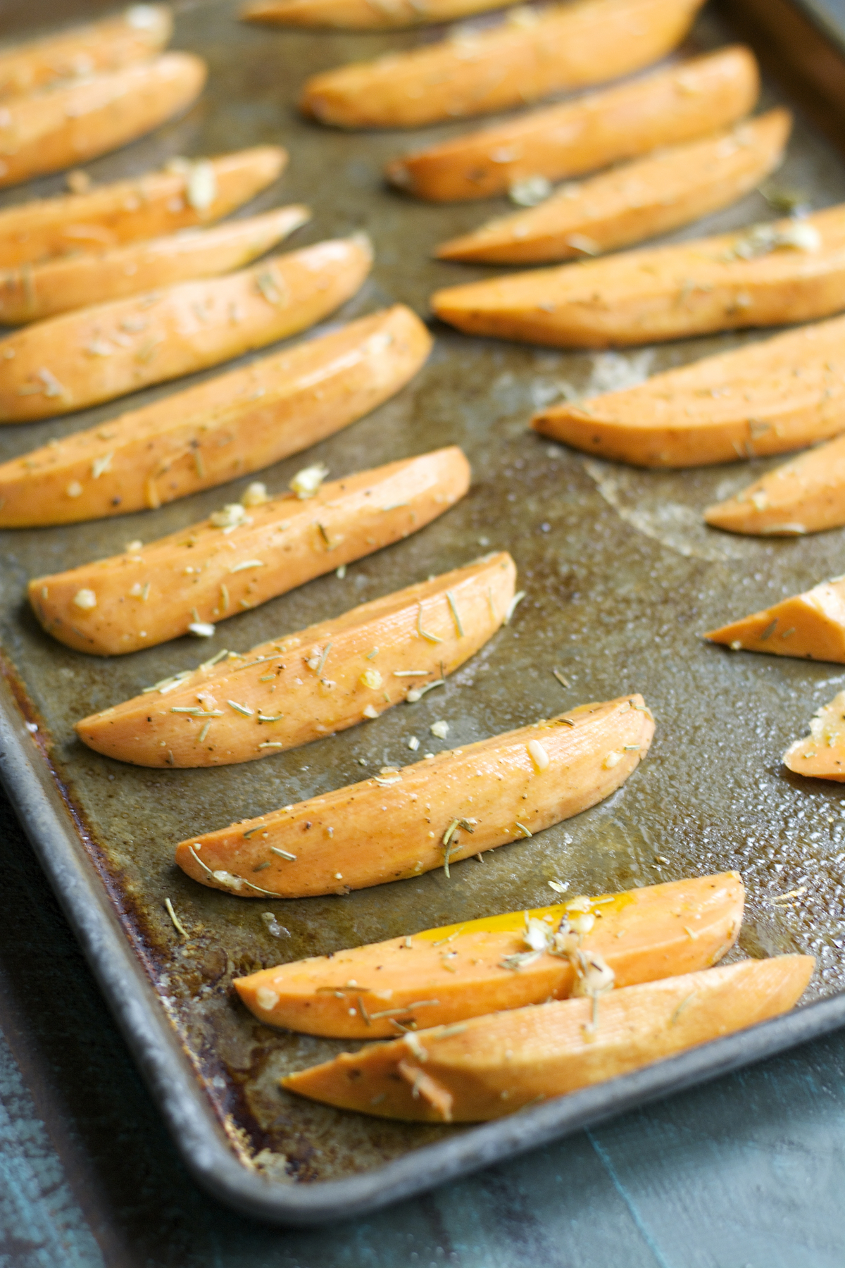 unbaked sweet potato fries on a baking tray