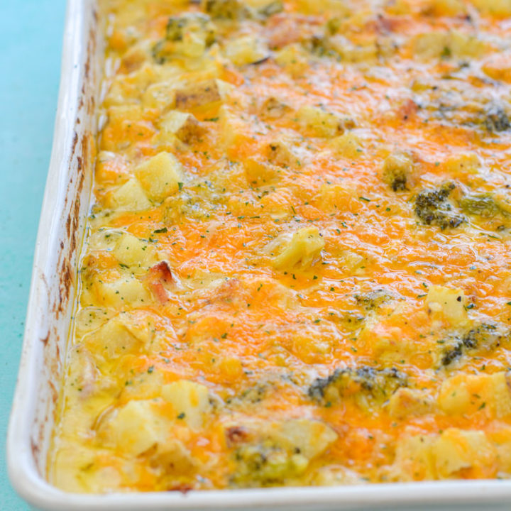This Cheesy Potato, Broccoli and Ham Bake is the perfect comfort food! This recipe is an excellent way to use up leftover ham for a quick and easy meal!