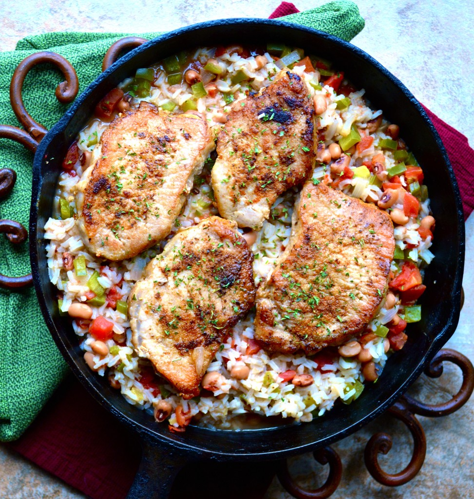 overhead view of cast iron skillet pork chops and rice