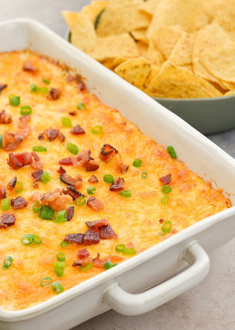 This hot Crab and Artichoke Dip is sure to be a winner at your next get together! Packed tender crab meat, artichokes and three kinds of cheese this is the ultimate party dip!