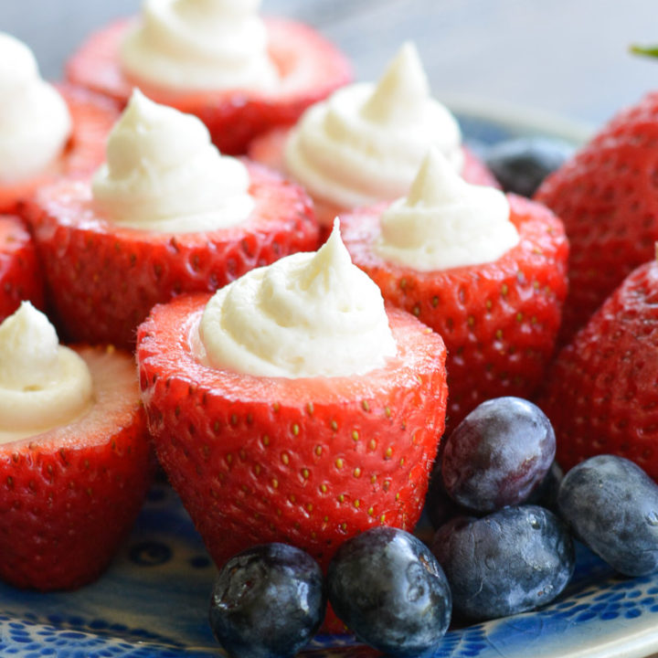These Cheesecake Stuffed Strawberries look fancy, but they're a breeze to make! Perfect for picnics and potlucks!
