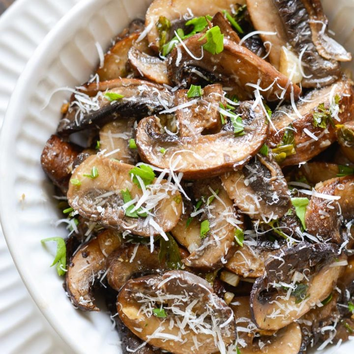 These Italian Baked Mushrooms are smothered in a delicious butter, garlic and herb sauce! This is the perfect easy, low carb side dish recipe!