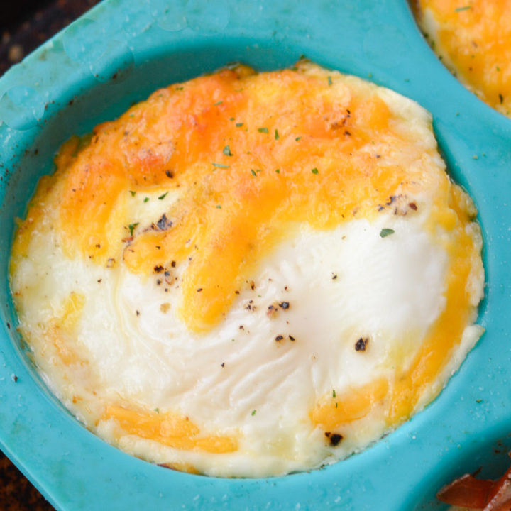 Try these Easy Cheddar Baked Eggs for a quick, low carb breakfast! You only need four basic ingredients to make this protein packed breakfast recipe!