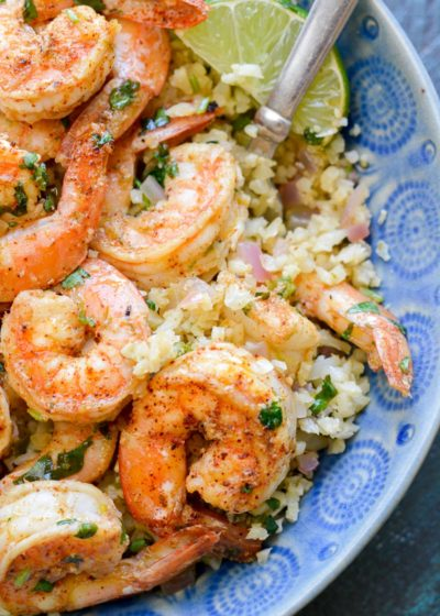 This Cilantro Lime Shrimp and Cauliflower Rice is low calorie, low carb, keto-friendly and packed with flavor! This is a 20 minute meal your entire family will love!