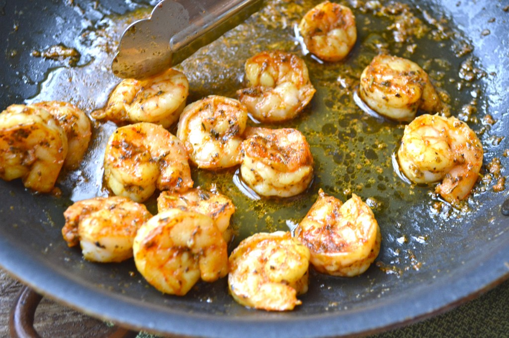 spiced shrimp cooking in a skillet