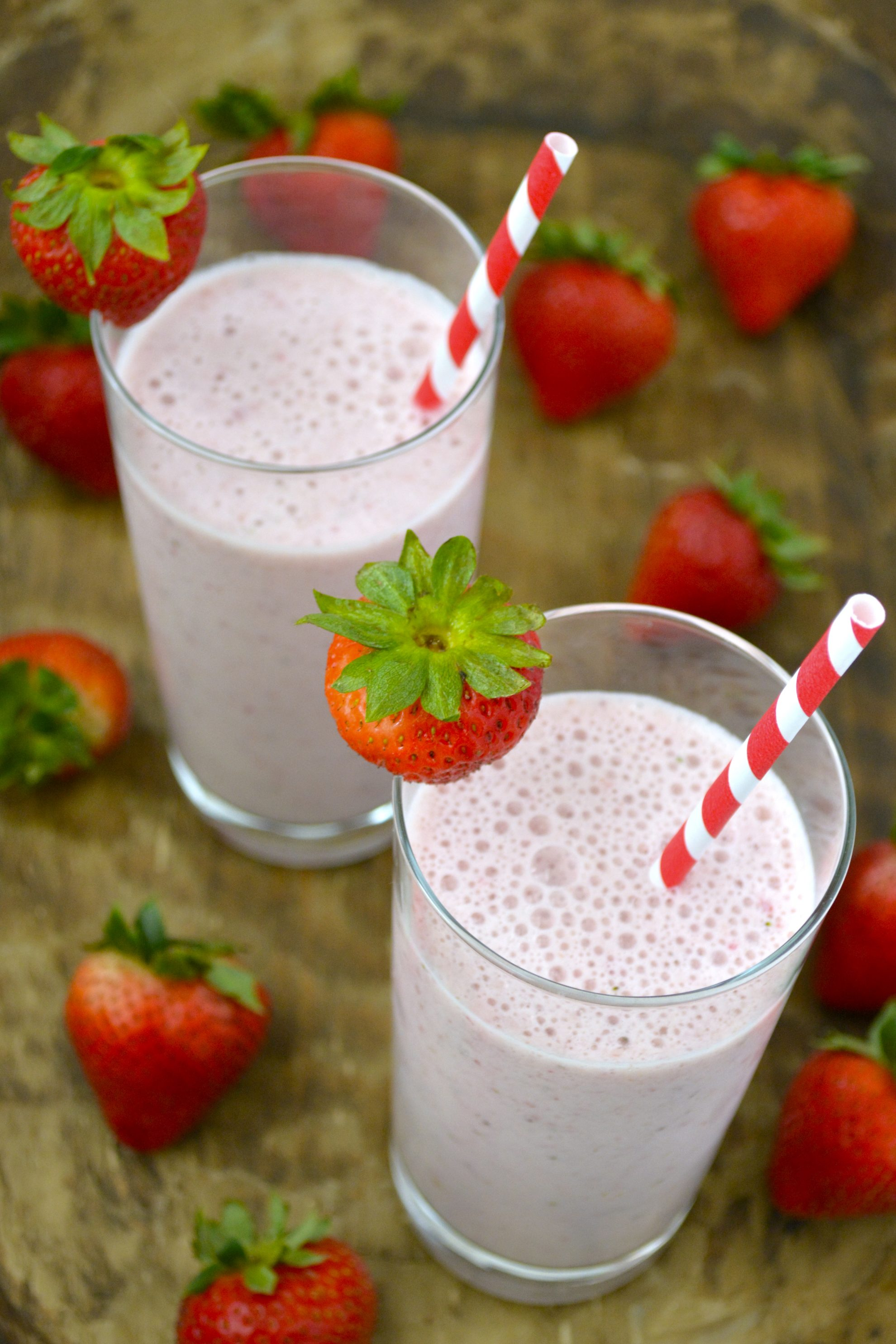 two glasses of homemade strawberry milk