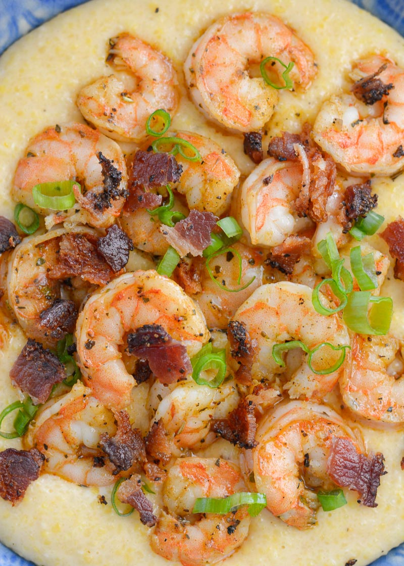 Cheesy Shrimp and Grits are the ultimate southern meal! Cheesy grits, spicy shrimp, crispy bacon and fresh green onions are perfect comfort food!
