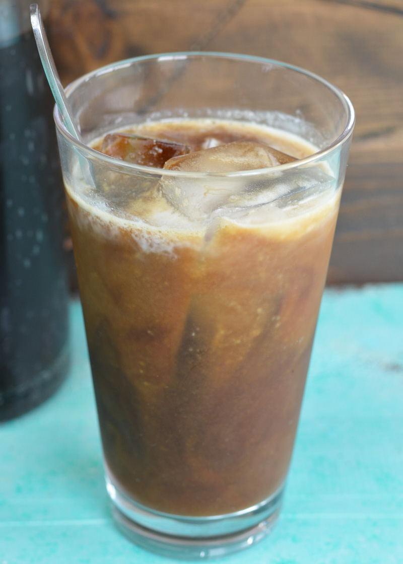 This Simple Iced Coffee is made using cold brew coffee. Learn just how easy it is to make a perfect large batch of iced coffee for a fraction of the coffee house price!