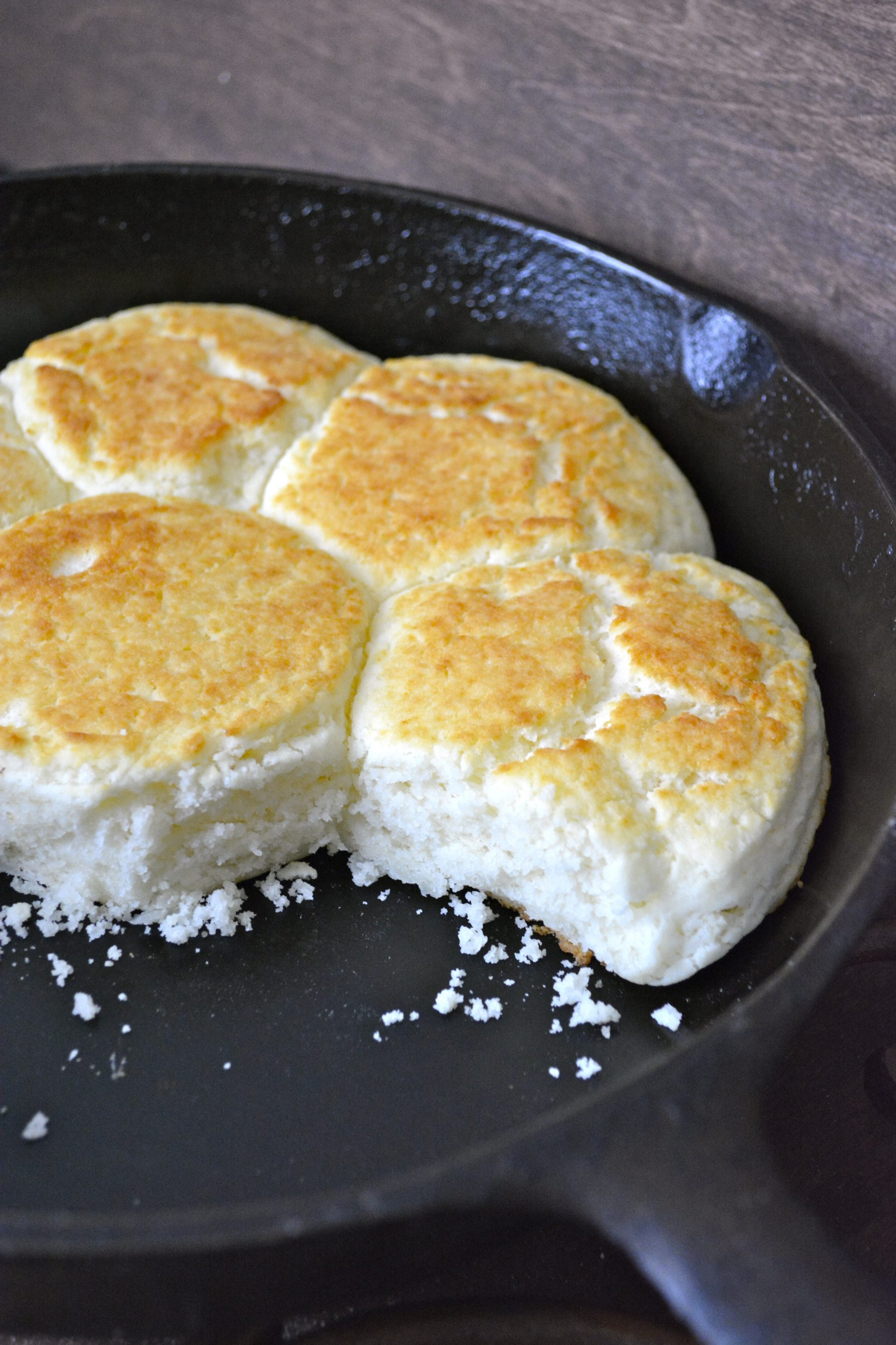 four gluten free biscuits in a cast iron skillet
