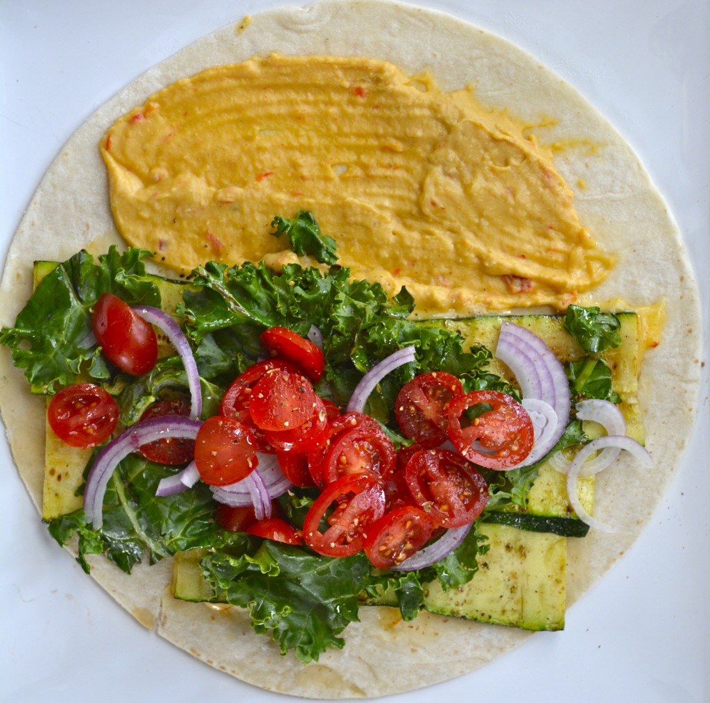 overhead view of a hummus veggie wrap before it's been rolled up