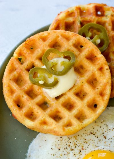 Try these quick and easy Jalapeño Cheddar Cornbread Waffles for a savory breakfast. These cornbread waffles are excellent for making hearty breakfast sandwiches, served with bacon and eggs or a scoop of chili on top!