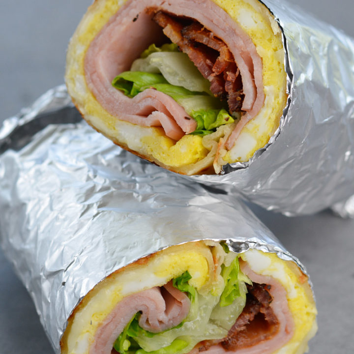 This Bacon, Ham, and Egg Wrap with Honey Dijon Sauce is a hearty breakfast wrap that your whole family will love!