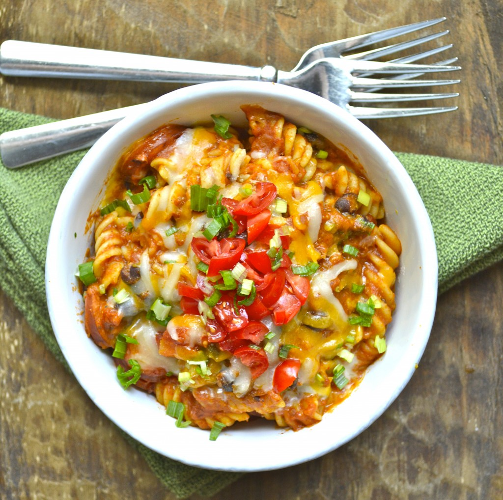 This easy One Pan Pasta is a quick, 30-minute meal that is packed with Spicy Sausage and Black Beans! The perfect one-dish family dinner!
