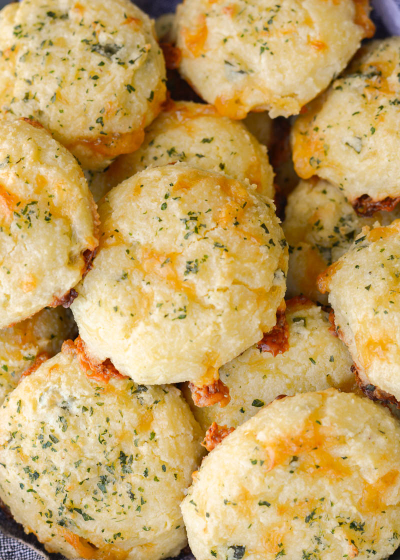 These Keto Three Cheese Biscuits are perfectly soft and fluffy! Each low carb biscuit is loaded with sharp cheddar cheddar, mozzarella and fresh basil for just 2 net carbs each!