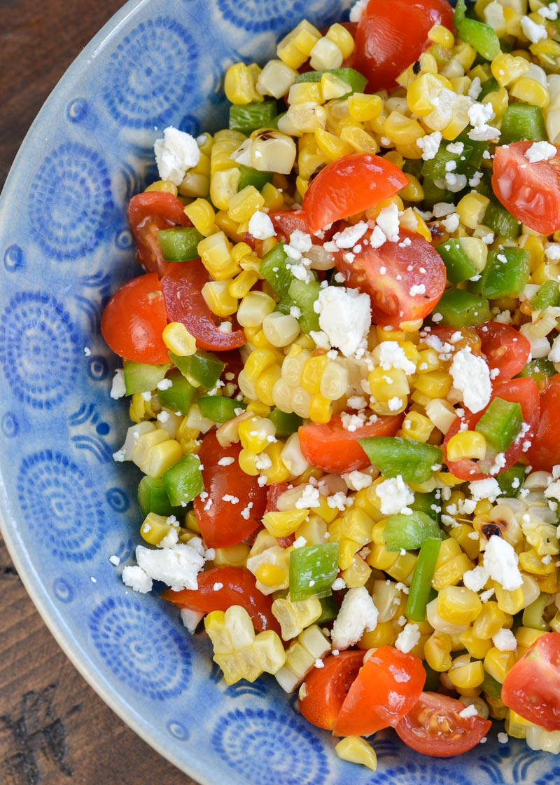 Make this Corn and Tomato Salad recipe for your next potluck or BBQ. It's a quick and easy summer side dish that everyone loves!