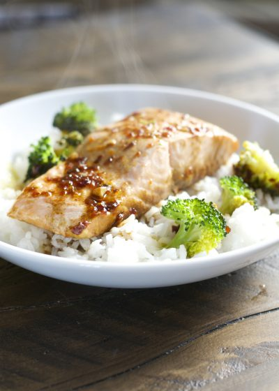 These Chili Garlic Salmon and Broccoli Bowls are packed with tangy Asian flavor, fresh broccoli and perfectly tender salmon! This is an easy and healthy weeknight dinner ready in under 20 minutes!