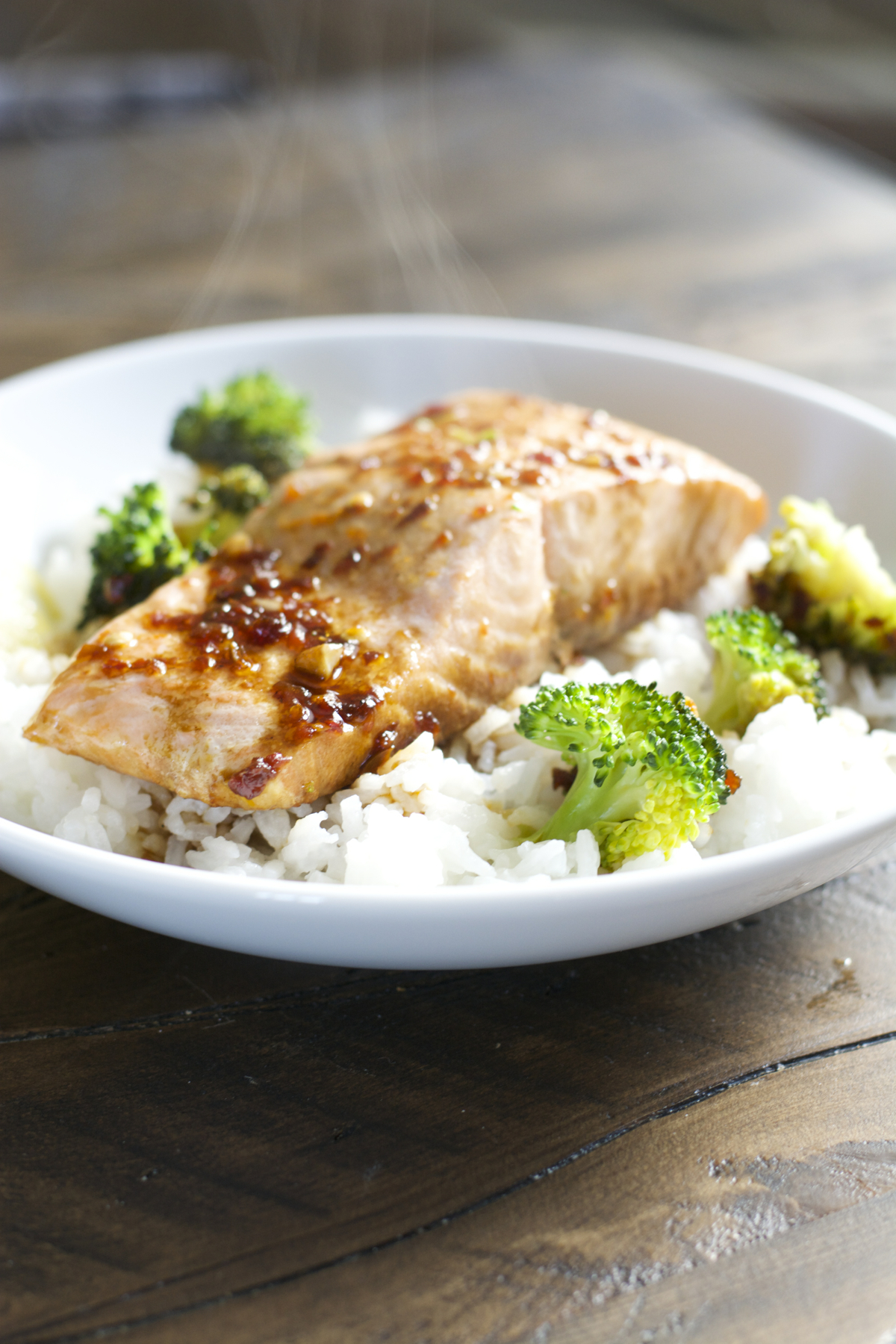 a salmon and broccoli bowl with rice