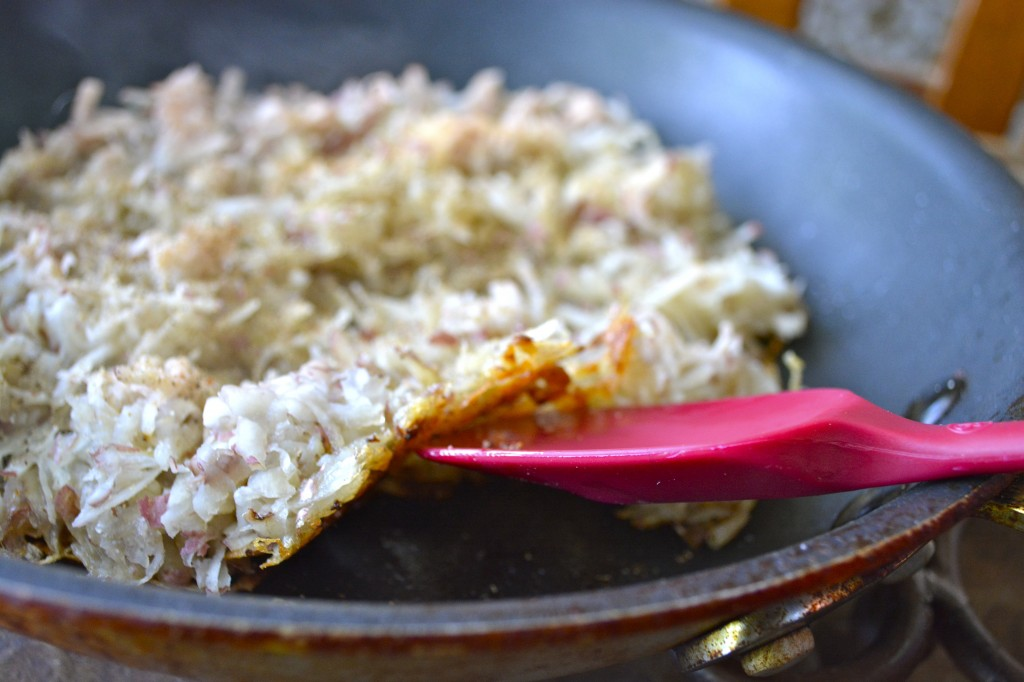 process shot showing how to make crispy hash browns in a skillet