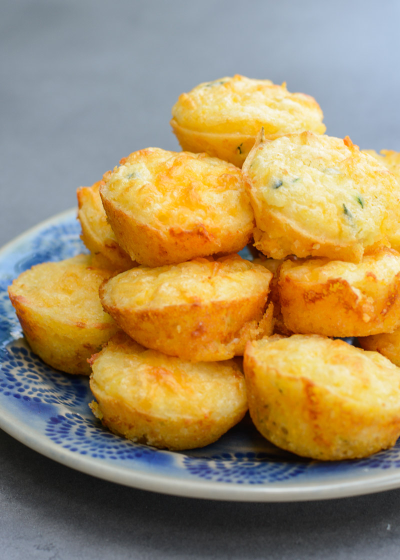 These fluffy, moist Cheddar Corn Muffins have an amazing, healthy, super secret ingredient! It's the perfect dinner side to help sneak more vegetables into your diet with no complaints!