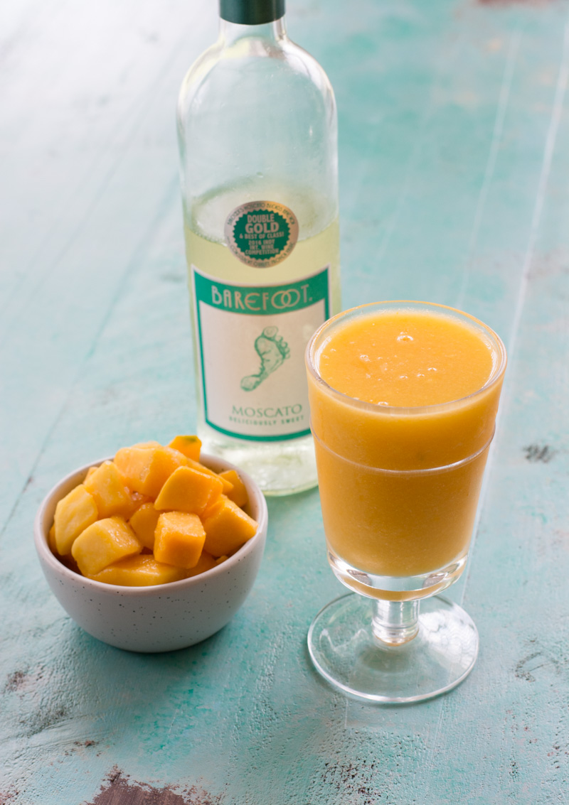 This sweet and delicious Mango Moscato Smoothie has only two ingredients and is perfect for all your summer parties!