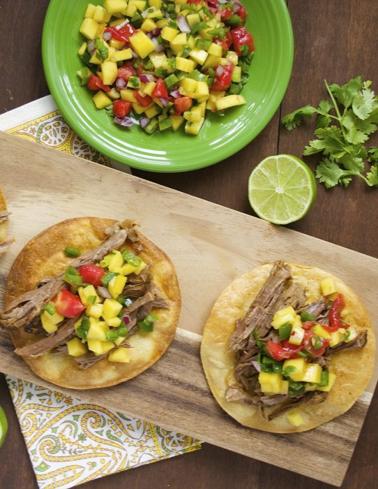 Shredded Beef Tostadas are topped with fresh Mango Salsa! Delicious, easy and totally different!