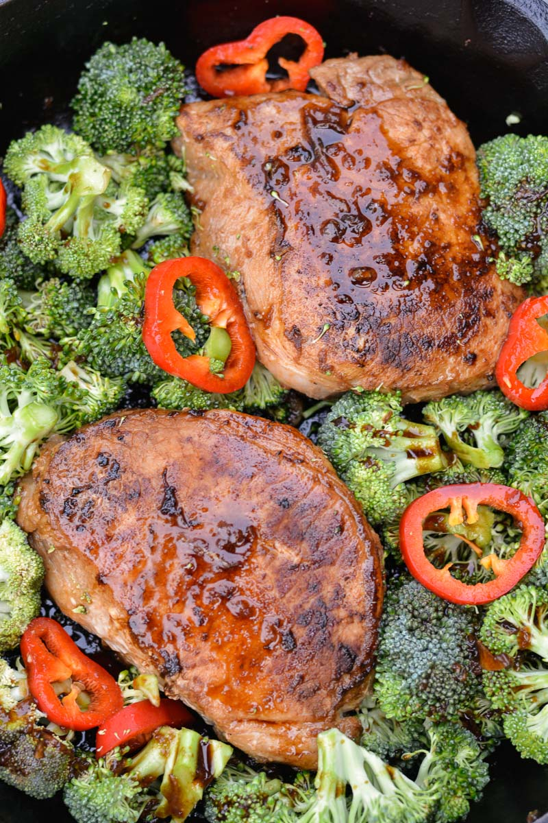 Add your vegetables, then throw your Asian Pork Chops into the oven to roast with the sauce for an easy weeknight one pan keto meal!