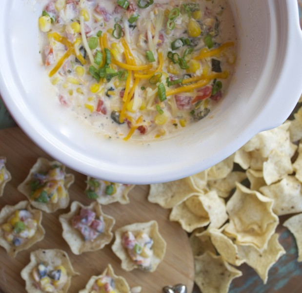 Slow Cooker Sweet Corn Dip makes for an impressive appetizer without any work! Just toss your ingredients in the slow cooker and come home to a creamy, cheesy dip!