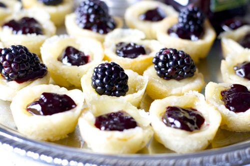 baked brie appetizer bites on a silver tray