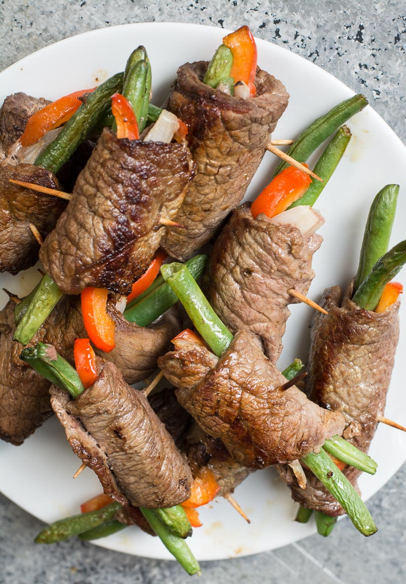These easy Keto Steak Rolls are loaded with flavor. Flank steak is wrapped around green beans, peppers and onion, just 4 net carbs per serving!