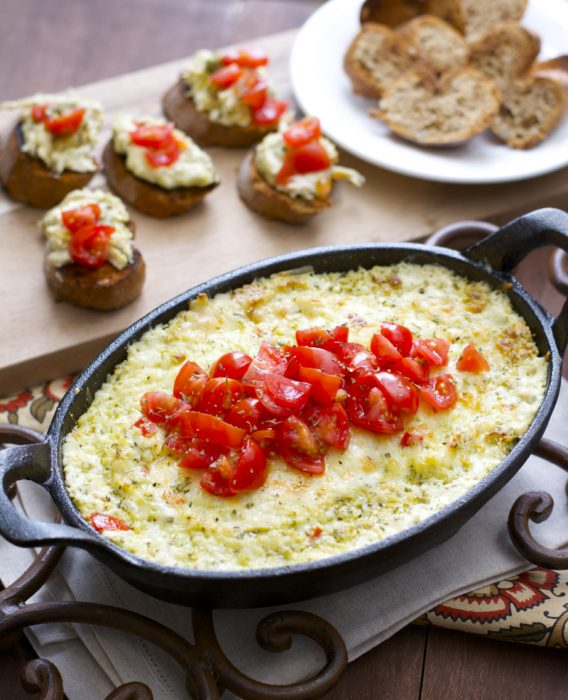 Cheesy Chicken Pesto Dip, this super easy cheesy dip will be a hit at your next party!