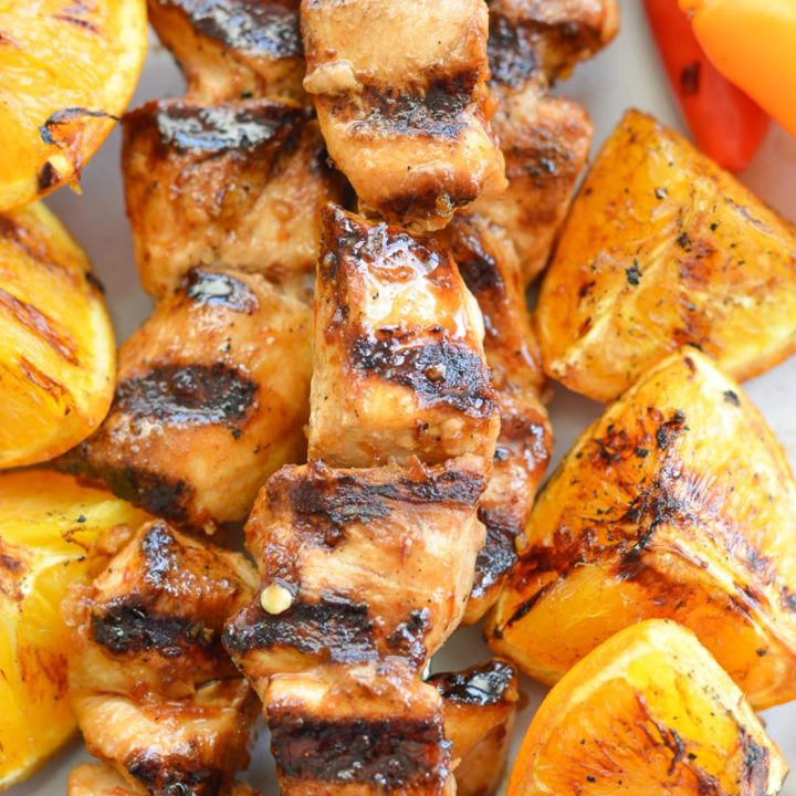 These Orange Sesame Chicken Skewers are loaded with sweet and spicy Asian flavor! Pair with grilled orange wedges for a real treat!