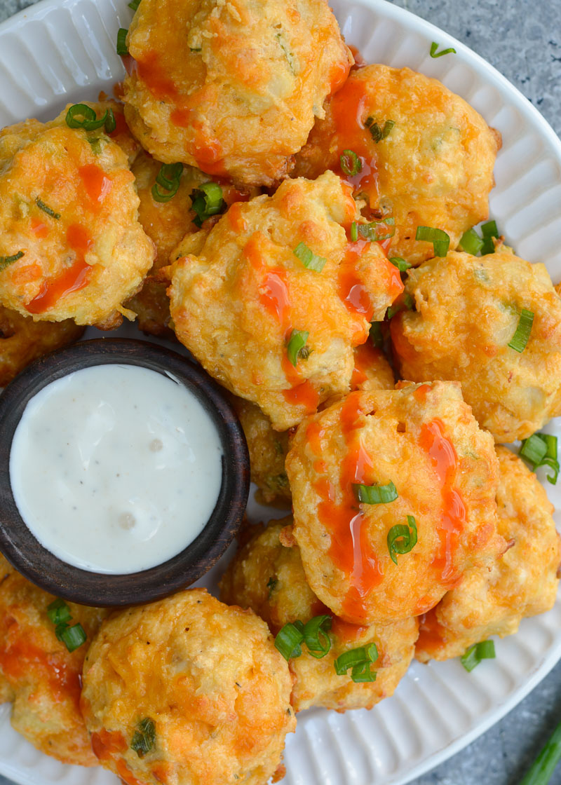 These Cheesy Buffalo Chicken Bites will be a new keto-friendly favorite! Cheesy almond flour bites are packed with spicy Buffalo Chicken for the perfect snack under 1 net carb!