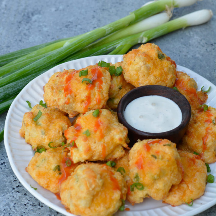 These Cheesy Buffalo Chicken Bites are the perfect low-carb snack with blue cheese dip!