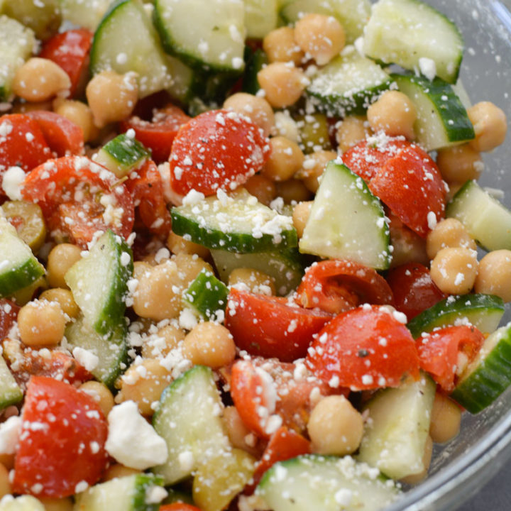 This Healthy Chickpea Salad is packed with chopped cucumbers, cherry tomatoes, chickpeas, feta and tossed in a simple lemon vinaigrette.