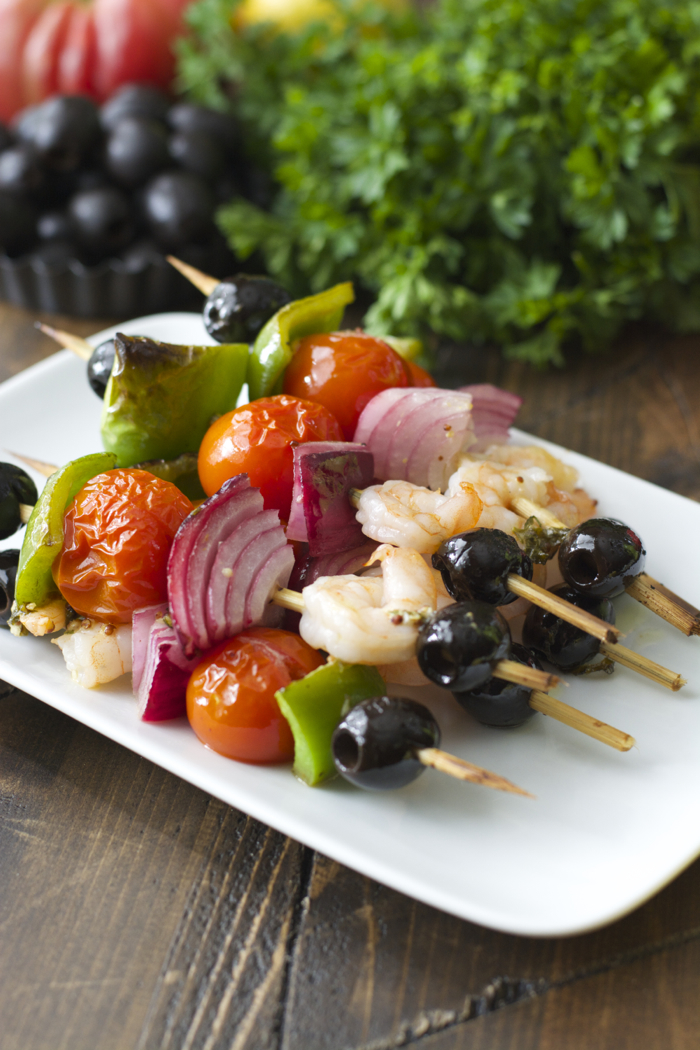 These Mediterranean Shrimp Skewers are packed with shrimp, fresh vegetables and black olives tossed in a zesty basil vinaigrette! This low carb, keto dinner has under 6 net carbs per serving!