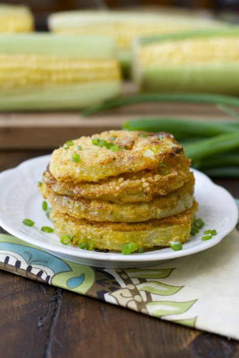stack of four southern fried green tomatoes on a white plate