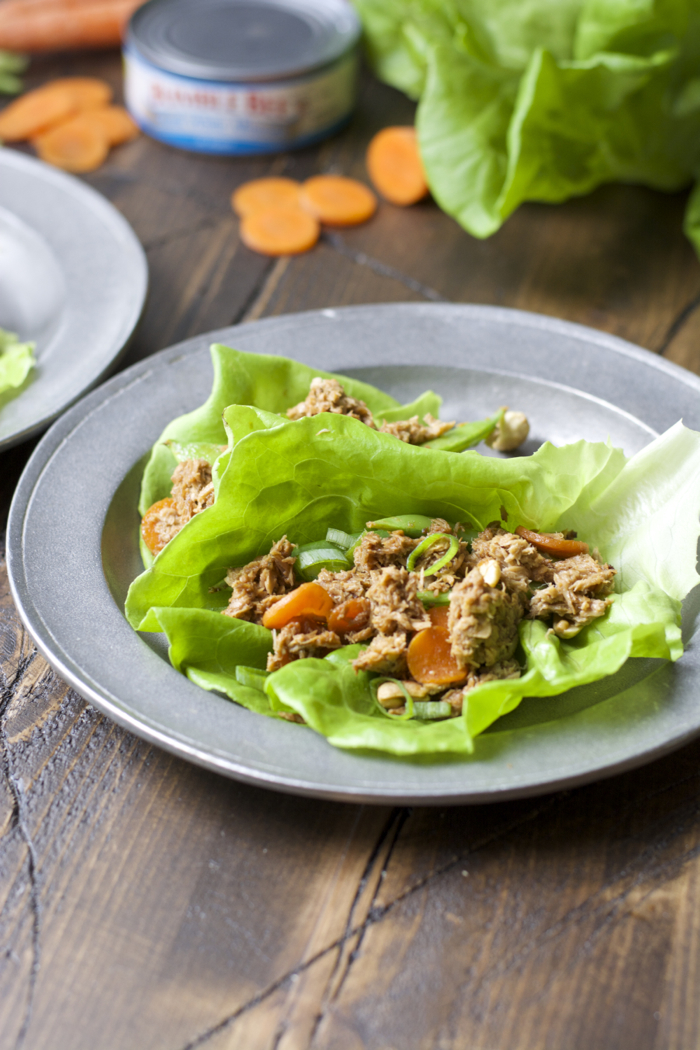 two tuna lettuce wraps on a plate.