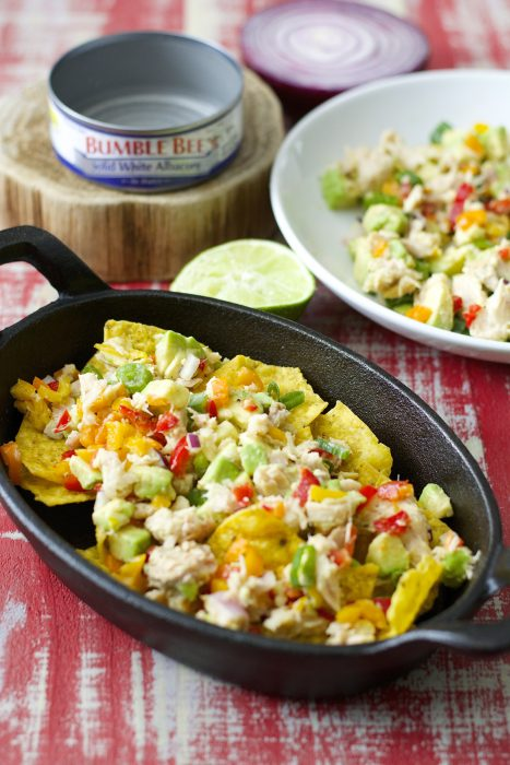 Crispy nachos are topped with fresh avocado, sweet peppers, tuna and lime juice! These healthy and easy Tuna Nachos are the perfect easy weeknight meal!