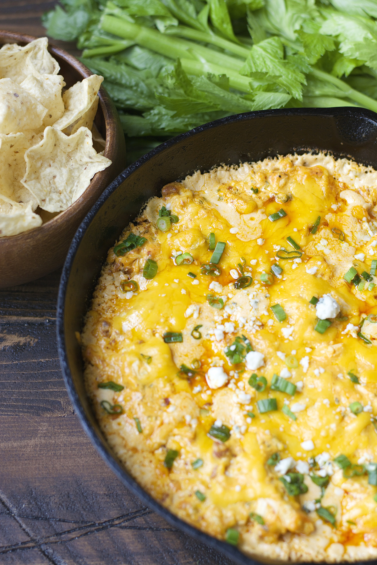 This Blue Cheese Bacon Buffalo Chicken Dip is packed with tangy buffalo sauce, crunchy celery, salty bacon, loads of cheese and shredded chicken! This is the ultimate game day appetizer!