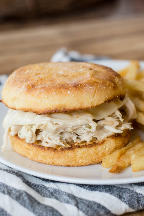 These Slow Cooker Cheesy Chicken Ranch Sandwiches are incredibly easy to make and only have a few basic ingredients! This zesty ranch chicken is loaded on buttery English muffins and melted provolone cheese for a satisfying sandwich!