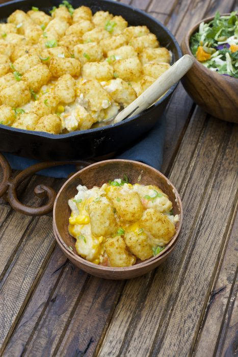 This Lightened Up Tater Tot Casserole is packed with lean ground turkey, loads of vegetables and a creamy homemade cheddar sauce! A perfect gluten free dinner for even your pickiest eaters!