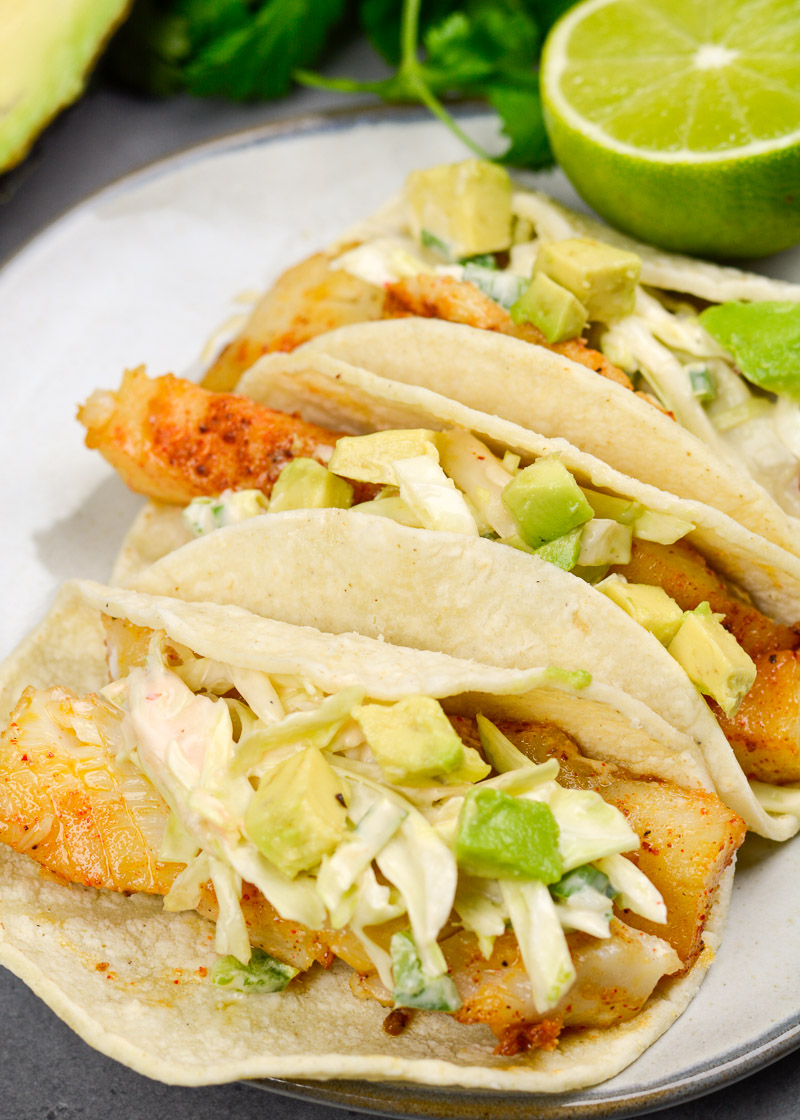 These light and healthy Easy Fish Tacos with Zesty Slaw are packed with flavor and ready in just 20 minutes! This dish is gluten free and perfect for busy weeknights!