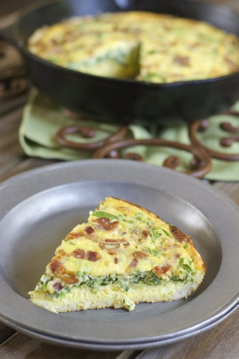 This Keto Bacon Jalapeno Quiche is an easy hearty dish your family will love! Loaded with crispy bacon, fresh jalapeño, shredded gouda and chopped spinach this will become a fast favorite!