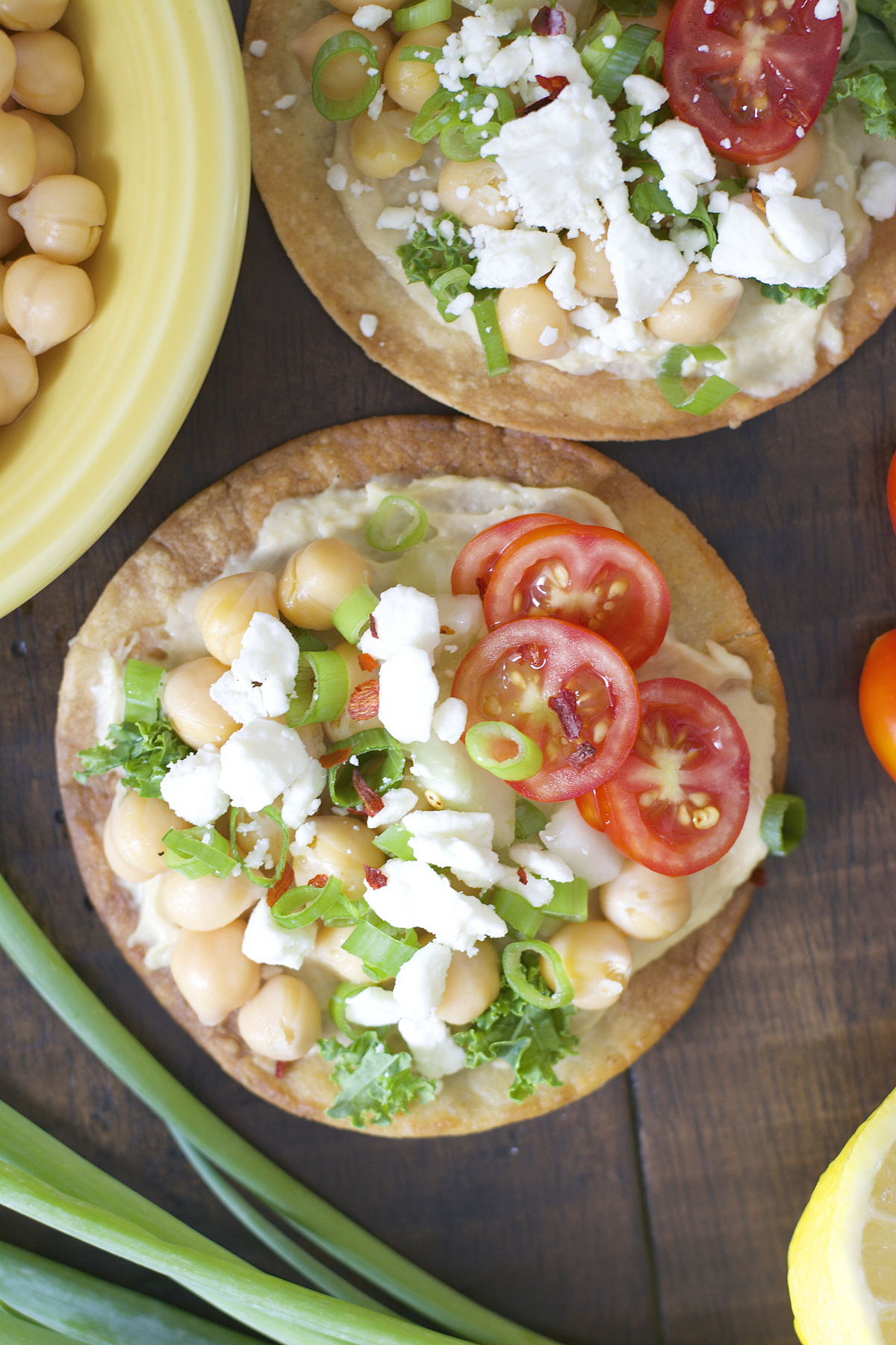 These Mediterranean Hummus Tostadas are an effortless idea for entertaining! Crispy tostadas are topped with creamy hummus, tender chick peas and fresh veggies!