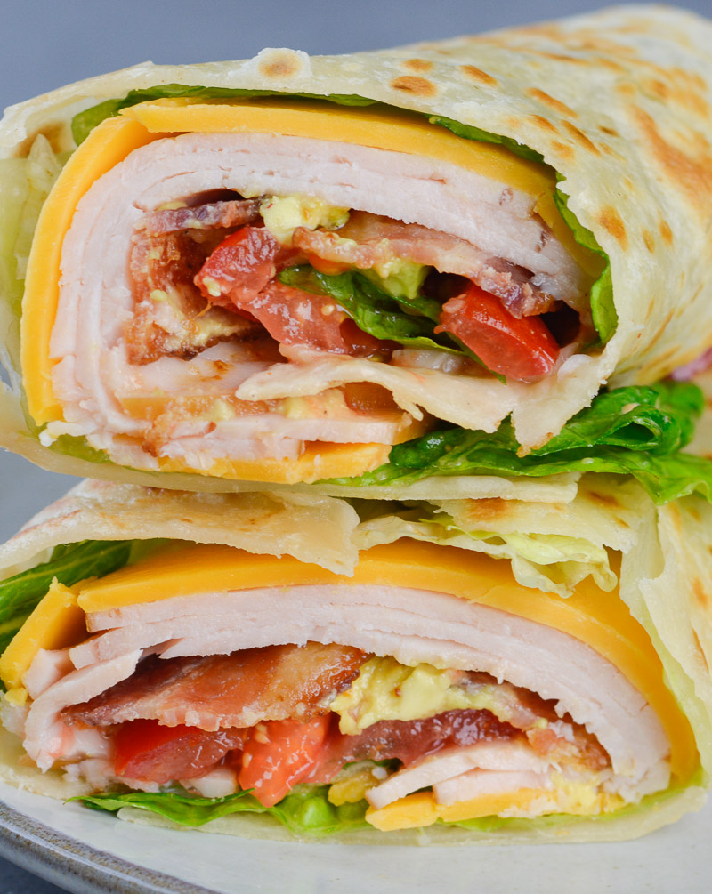 This California Turkey Club Wrap is packed with fresh vegetables, deli turkey and crispy bacon! The perfect easy wrap recipe!