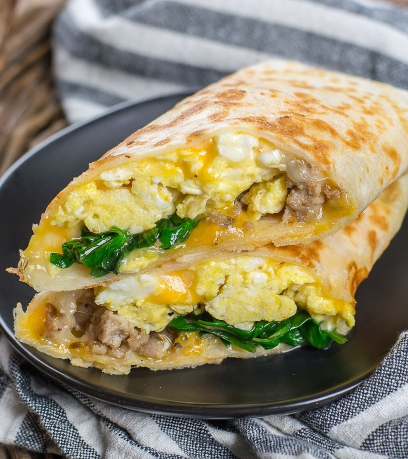 This quick and easy Breakfast Burrito is loaded with spinach, sausage, eggs and cheese!