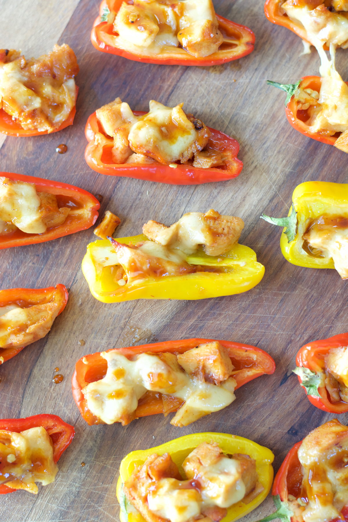 This simple six ingredient dish is perfect for Summer entertaining! Your guests will love these sweet and spicy Chipotle Chicken Stuffed Peppers!