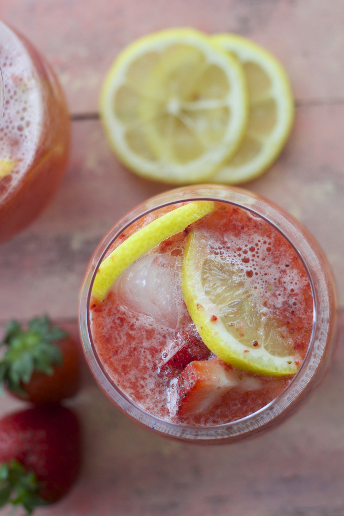 overhead view of a glass of homemade strawberry lemonade