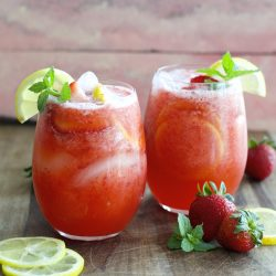 This refreshing Strawberry Lemonade is packed with fresh strawberries, lemon slices and mint and it is SO easy to make! It is the perfect way to beat the heat!
