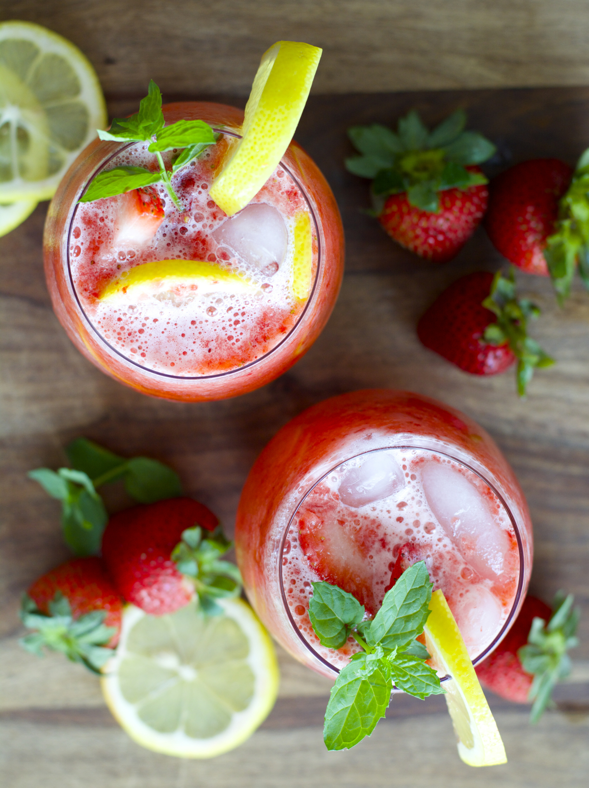 overhead view of two glasses of strawberry lemonade
